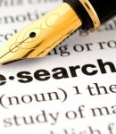 photo of pen with definition of the word Research