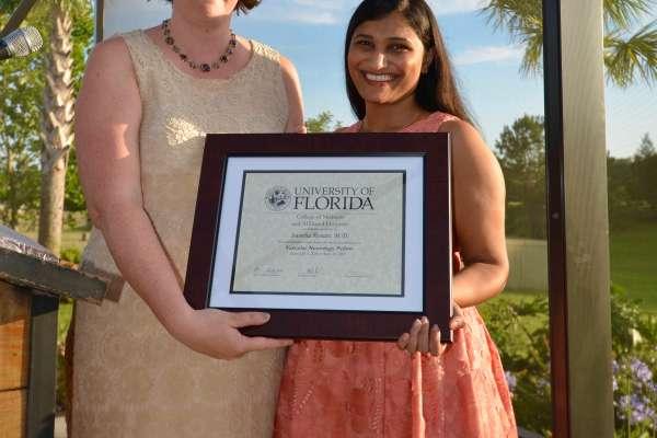 Resident receiving award
