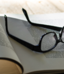 Photo of book with glasses