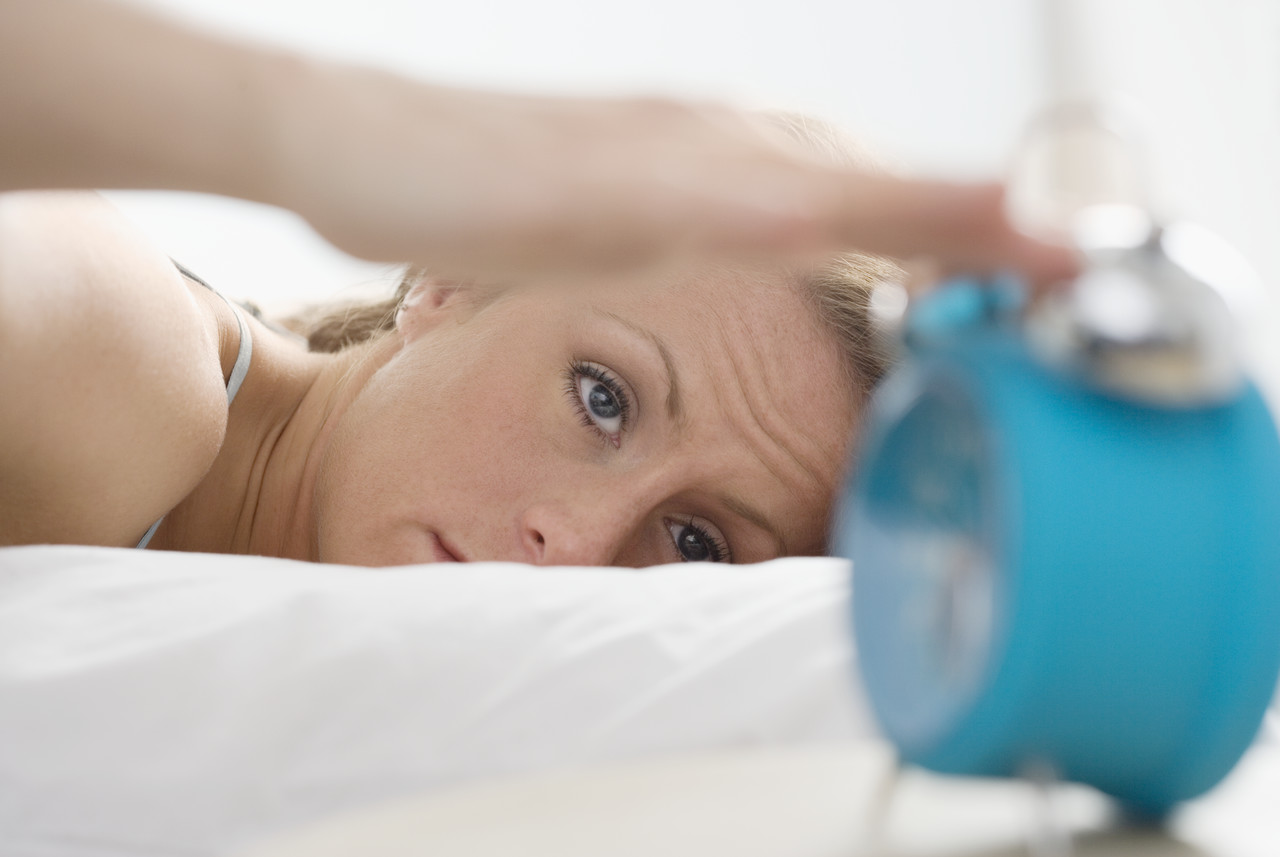 woman and alarm clock