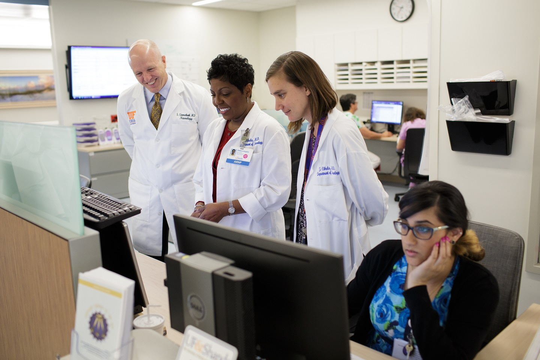 Image of doctors looking at EEG monitor